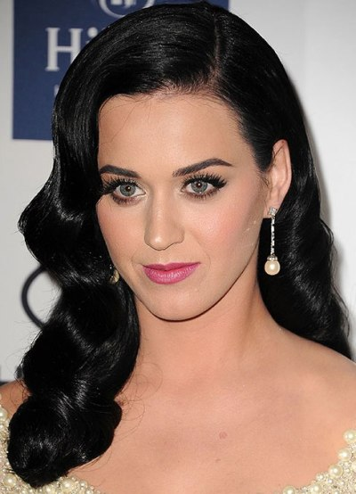 Katy Perry's Long Black Hair Is Styled In Vintage Waves.
