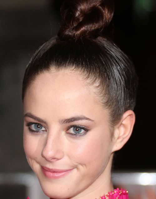 Kaya Scodelario's Long Straight Brunette Hair In Simple Top Knot