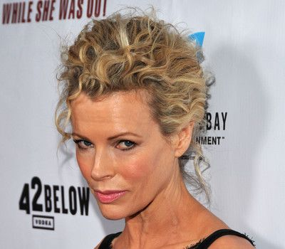 Kim Basinger's Blonde Curly Hair In Formal Updo Hairdo