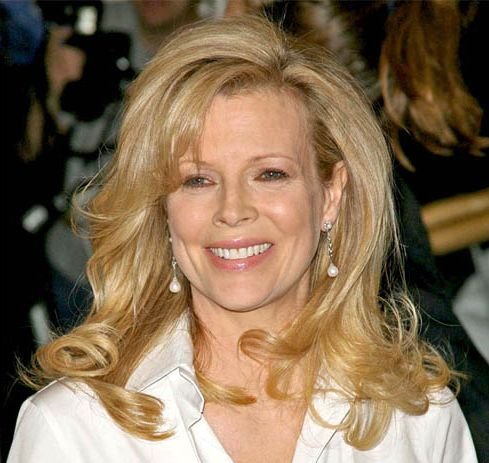 Kim Basinger's Blonde Hair In Formal Long Wavy Hairstyle