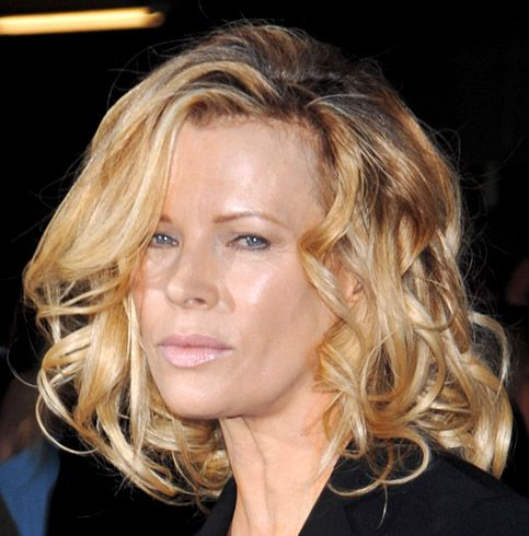 Kim Basinger's Medium-Length Blonde Hair In Formal Wavy Hairstyle