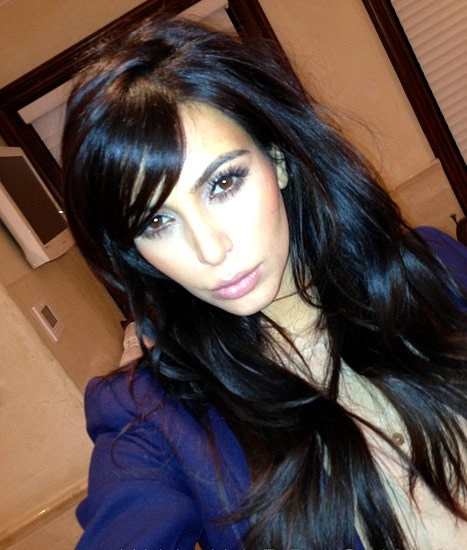 Kim Kardashian's Long Black Wavy Layered Hair With Side Bangs