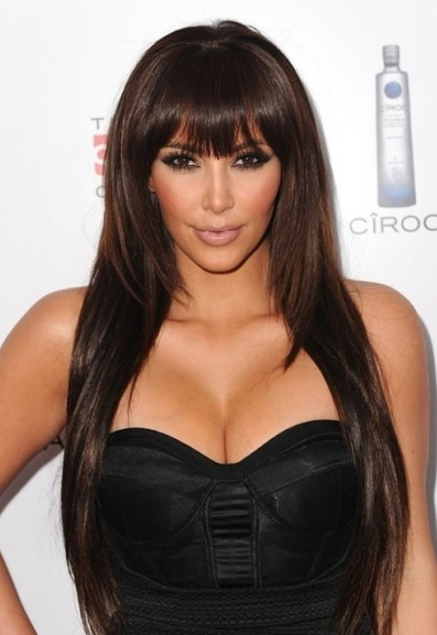 Kim Kardashian's Long Layered Hairstyle With Blunt Bangs