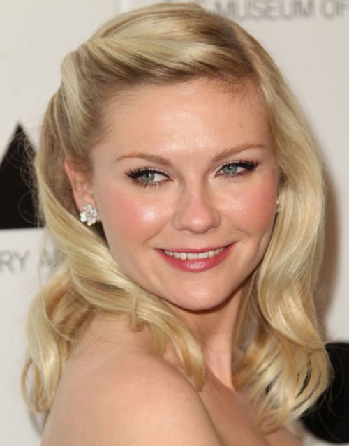 Kirsten Dunst's Medium Blonde Hair In Simple Feminine Prom Hairdo