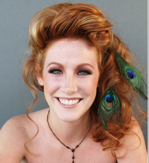 Long Auburn Hair In Formal Half Updo With Peacock Feathers