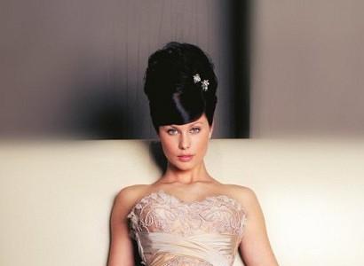 Black Sleek Straight Hair In Teased Up Beehive Wedding Hairdo