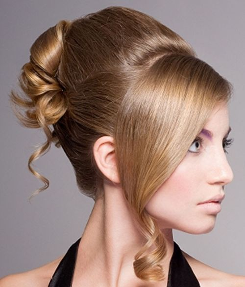 Long Blonde Hair In Elegant Formal Spiral Curled Updo