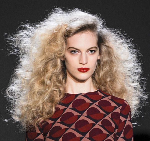 Long Curly Blonde Hair In Voluminous Back-Combed Hairstyle