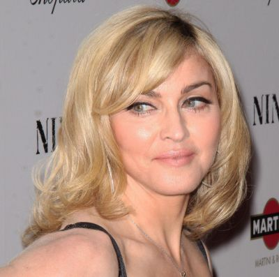 Madonna's Blonde Hair In Sexy Medium Wavy Mature Hairstyle