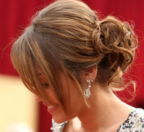 Miley Cyrus's Long Brown Hair In Messy Curly Chignon