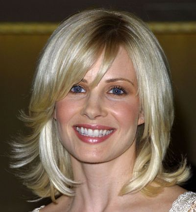 Monica Potter's Medium-Length Blonde Playful Shag Hairstyle