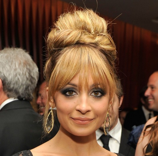 Nicole Richie's Hair Is Styled In A Retro Bouffant Updo.