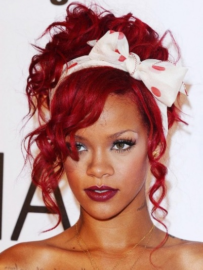 Rihanna Curly Red Playful Formal Hairdo With Large Hairbow