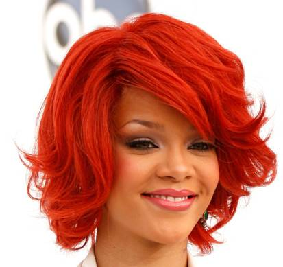 Rihanna In A Playful Wavy Red Layered Bob Hairstyle