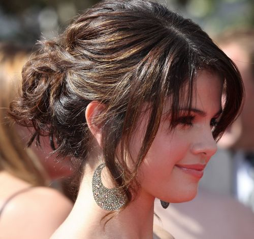 Selena Gomez's Brunette Hair In Simple Curly Updo For Prom