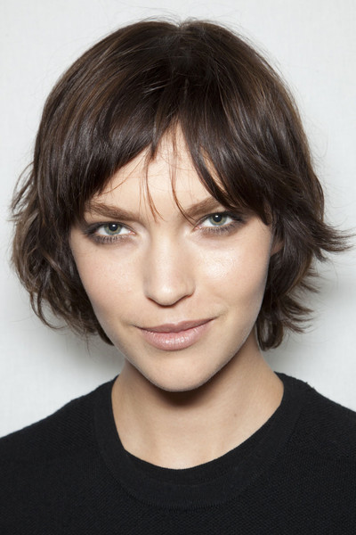 Short Brunette Hair In Choppy Layered Hairstyle With Bangs