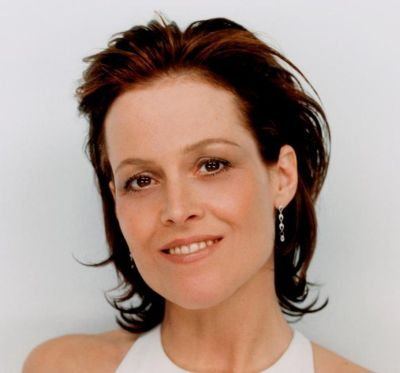 Sigourney Weaver's Brown Hair In Short Wavy Pushed Back Hairstyle