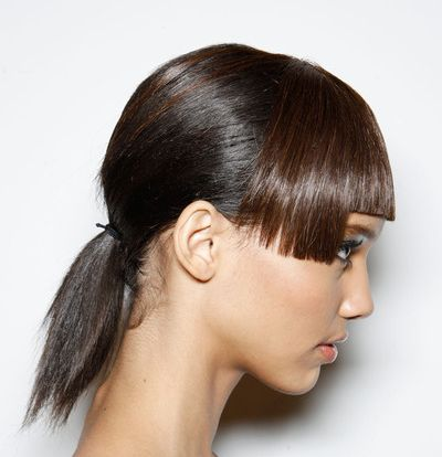 Straight Brown Hair In Low Ponytail With Blunt Bangs