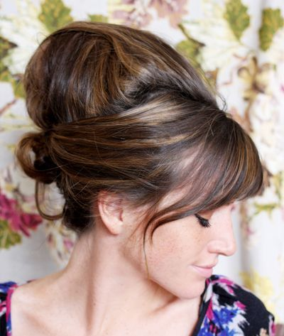 Straight Hair In Teased Up Sexy Retro Beehive Formal Hairdo
